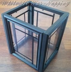 Lantern - use picture frames (from dollar store) and paint black. Glue them all together. She added vinyl on the glass for extra. Links to similar lantern chandelier (just add old chandelier guts to the lantern).