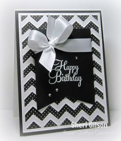 handmade birthday card from Paper Crafty's Creations ... black and white ... wide fishtail banner with sentiment ... perfect satin bow ... white chevron coverplate die cut over black with polk dots ... great graphic appearance ...