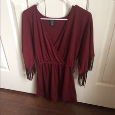 NWT Maroon Romper Brand new with tag maroon romper. Excellent condition. 3\4 sleeve with fringes. No trades please. We do bundles! Rue 21 Pants Jumpsuits & Rompers