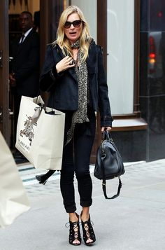 Kate Moss carrying a top handle purse and wearing sexy strappy lace-up heels while shopping