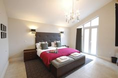 Luxury, contemporary master bedroom from the Stoke by Nayland lodges on the site of the old WWII Land Army.