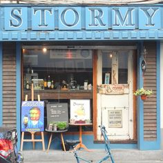 goodness gracious i love everything about this! the easels! the funny sign on the door!(Stormy Cafe, Shanghai)