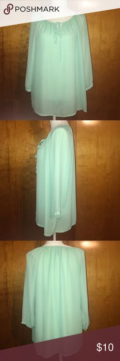 Mint green polka dot tunic top. Size M Mint green polka dot tunic top. Size M. Adorable!!! 3/4 sleeve with tie in front! Tops Blouses