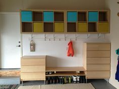 Garage storage. All shelving from IKEA, a drawer for each kid's items (bike helmet, toys, etc), storage underneath for shoes, hooks for swimsuits/towels in the summer and snow pants/coats in the winter. I ♥ it :)  No link, just the picture.