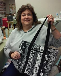 Jeannie's black and white purse. Made in the quilted fabric purse class at Jenny's Sewing Studio. http://www.jennys-sewing-studio.com/index.php/instructional-sewing/sewing-classes.html