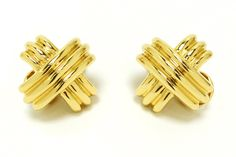 These iconic Tiffany & Co. 18k gold X earrings by designer Jean Schlumberger make a bold statement with the classic crossover or criss-cross design. They feature a secured, pierced omega back closure which can be modified to a clip on if desired. Originally made in 3 sizes, these are the large, retired and rarely available on the secondary market. #tiffany #18k #goldearrings #tiffanyandco #estatejewelry #love #tiffanyandcompany #tiffanyearrings #xearrings #x #jeanschlumberger #schlumberger Tiffany Earrings, Gold Earrings, Secondary Market, Tiffany And Co, Cross Designs, Antique Earrings, Crossover, Criss Cross, Omega