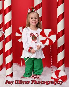 DIY ideas for Christmas background props (ribbon on white tubes), spray painted styrofoam rounds on dowels to look like peppermint candy