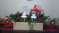 Beautiful Christmas crate with fresh balsam and lanterns
