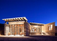 Rammed-earth and stone villa in Mexico.