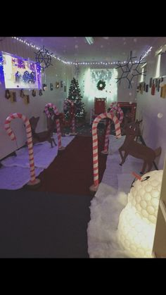 Santa's grotto, walkway, candy canes, falling snow, Christmas tree, snowman.