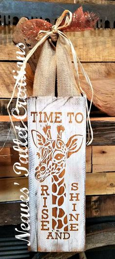 """RECYCLED WOOD PALLET:  The Rise and Shine Sign is 16"""" x 6"""" and hangs from a burlap ribbon 23"""". It is painted white and then stained so it could go in any room in your house, especially in a nursery. We are asking $12 for this sign. We could do another one in a different color if you ask us nicely! Thanks for looking and please feel free to share this post. Small local businesses need all the help we can get. Item #1,100"""
