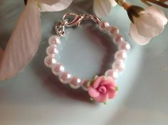 Check out this item in my Etsy shop https://www.etsy.com/listing/220813136/pearl-baby-bracelet-baby-gift-infant