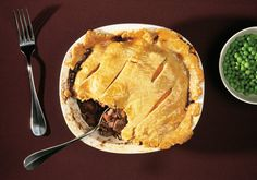 Beef in dark, silky gravy composed of fat and reduced stout, flecked with tender vegetables, covered in pastry - NYT Cooking Pie Recipes, Cooking Recipes, Cooking Beef, Cooking Corn, Irish Recipes, Sausage Recipes, Fall Recipes, Guinness Pies, Gourmet