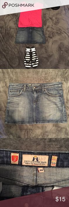 Juicy Couture mini skirt Cute juicy Couture mini skirt with bling heart on the back pocket, size 28, good condition and gently used, medium wash denim. Shirt and purse in pictures also available in other listings. Juicy Couture Skirts Mini