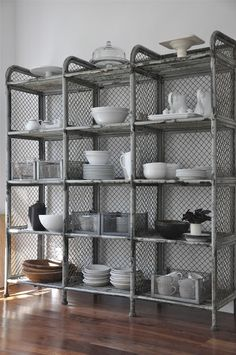 Not crazy about the shelf itself but I do like the idea of the grate mesh behind. This would work with some other pipe shelves I saved