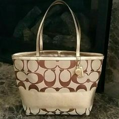 Coach Signature Jacquard Metallic Gold Stripe Tote Authentic, gently used signature jacquard medium tote in tan with metallic gold stripe, leather trim and handles. Hook clasp closure, clean, no rips, tears or smudge elsewhere. ℹCorners may have very minor wear but totally unnoticeable unless you will look for it. Handles are in awesome shape, free from cracking or peeling. Inside is lined with satin fabric, clean and free from stains. Lightweight and classic tote, goes well with everything…