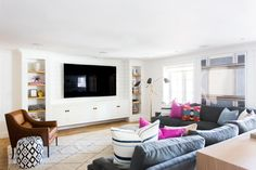 Basement Living Area    Studio McGee - love the built-ins around the TV and color combination-