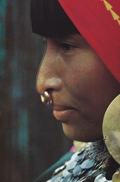 South America | Portrait of a Kuna Indian woman with a traditional nose ring, San Blas Islands, Panama