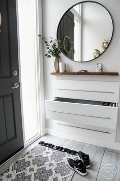 DIY Split Level Entry Makeover- I LOVE this entry. The oversize door, scandi inf… DIY Split Level Entry Makeover- I LOVE this entry. The oversize door, scandi influence and that shoe storage! Pin: 736 x 1110 Entryway Storage, Home, Apartment Entryway, Foyer Decorating, Interior, Hallway Storage, Split Level Entry, Decorating On A Budget, Trendy Apartment