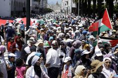 Moroccans stage a demonstration to protest the ongoing Israeli attacks in Rabat capital of Morocco. July 2014