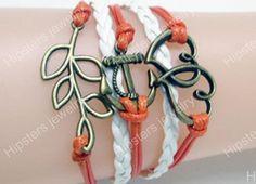 Charm bracelet leather bracelet double heart by Hipstersjewelry, $6.99