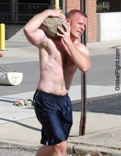muscleman carrying rocks boulder