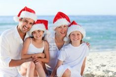 Family During Christmas Day At The Beach Royalty Free Stock Photo, Pictures, Images And Stock Photography. Image 10171552.