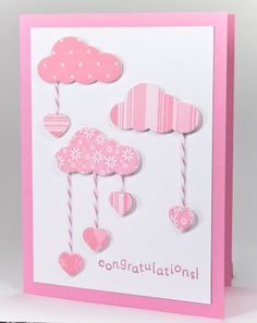 "Sweet heart ""drops"" will bring love to your favorite baby girl. Clouds have been punched in coordinating colors of pink patterned paper and the hearts attached with pink and white baker's twine. Handmade Baby Card."