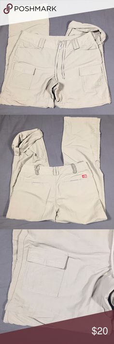 """North Face Convertible Khaki Nylon Pants Size 6 North Face Women's Convertible Khaki Outdoor Camping Hiking Nylon Pants Size 6  Fabric Content: 100% Nylon Good Pre-Owned Condition, a few blemishes from wear on the right leg (at the top and by the knee)   Measurements:  Waist: 14.5"""" Inseam: 29"""" Front Rise: 8.25"""" Leg Opening: 9"""" The North Face Pants"""