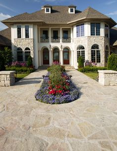 This home uses Buechel Stone's Fond du Lac Kensington Blend with stucco; and features a welcoming flagstone walkway with beautiful landscaping to create a sense of arrival. Visit www.buechelstone.com/shoppingcart/products/Fond-du-Lac-Ke... for more information on Fond du Lac Kensington Blend.