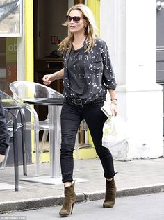 Star crossed: Kate Moss shows off her style in a star printed shirt and skinny jeans as she goes to pick yup some food in London