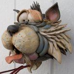 """I don't even know where to begin!  I have NEVER seen anything like this website full of cat, dog, critter, moose, dragon, fish, horse, llama, bear, etc. bird houses.  Yes, bird houses!  Amazing care, creativity, and craftsmanship!  Douglas Fey Pottery - nothing like it!  He calls them """"bird garglers"""" and he is passionate about it.  Order one, or use it to inspire your students."""