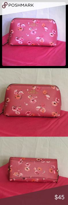 """COACH Wildflower Pink Cosmetic Makeup Bag COACH cosmetic bag in Dahlia Multi Wildflower print. Pink leather and gold hardware zipper. Small in size, measures 6.5-7"""" wide,  4"""" tall,  and almost 3.5"""" deep.  This actually came with a set I purchased and i just never really used it. Very good pre-owned condition! Coach Bags Cosmetic Bags & Cases"""
