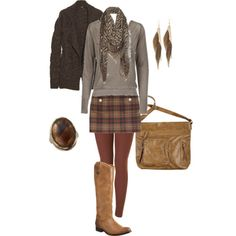 Plaid Skirt but I wouldn't wear those cowboy boots. I'd wear a different type of high boots.