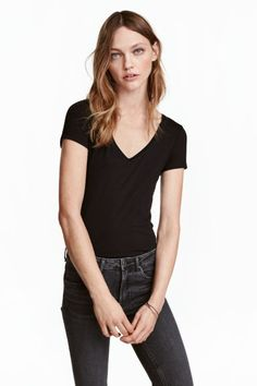 V-neck jersey top: Fitted top in soft stretch jersey with a V-neck and short sleeves.