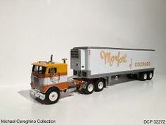 Diecast replica of Monfort of Colorado Freightliner COE, DCP 32272 (Michael Cereghino (Avsfan118)) Tags: scale truck wagon toy model colorado die circus engine semi replica cast lane 164 coe trucking promotions diecast dcp freightliner monfort cabover 32272 of
