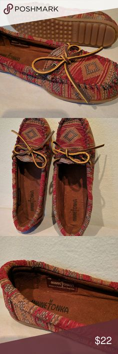 Moccasins by Minnetonka Southwestern pattern with burnt red color and blue and golden accents. Leather sole and upper. Leather strap tie on top. Never been worn, super comfy, very durable. I've got another pair that has lasted me several years. NWOT Minnetonka Shoes Moccasins