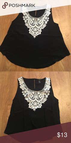 Forever 21 Small black tank top Black tank top with lace top details. Size small from forever 21. Worn once. Flowy fabric. Forever 21 Tops Tank Tops