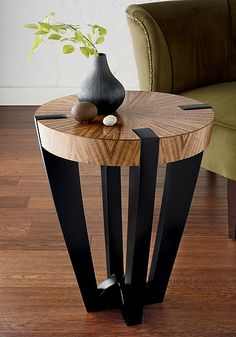 """Compass Side Table"" by #artist Enrico Konig This elegant table's unique appeal comes from the striking contrast of ebonized western maple legs, perfectly constructed to support and break through its beautifully figured and radially matched curly French walnut top."