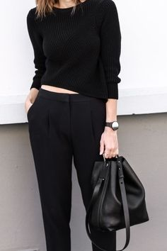 Chic Style - black outfit with short sweater, tapered trousers & bag