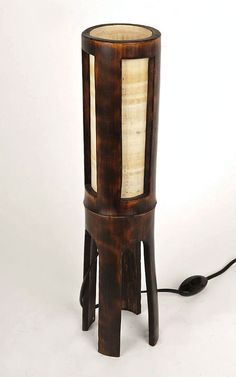 ☯ This stylish bamboo lamp is handmade with a passion and great attention to details in our workshop from a natural, fire cured bamboo pole, decorated with a lead tape and papyrus, and creates a natural and exotic atmosphere. ☯ Size /approximately/: height 16(40cm) x ø4(10cm) ☯ Included in