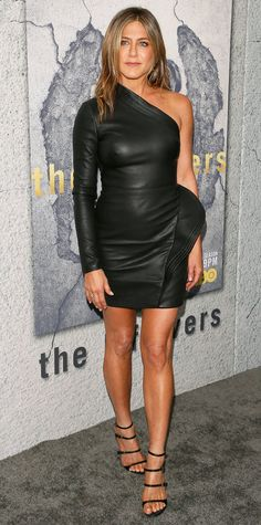 Jennifer Aniston was a total bombshell at the Season 3 premiere of HBO's The Leftovers, wearing this one-shoulder leather mini dress with asymmetrical pleat detailing. Count on her to go sans accessories, opting for just a pair of ultra sexy strappy heels to complete the look.