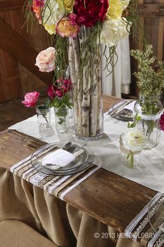 Small touches to your tables such as these wooden sticks in a glass vases will add a simple clean yet rustic look.