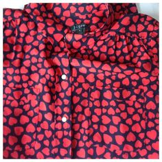 J. Crew silk heart blouse Valentine's Day or any day.... You can never have too many flowy feminine tops cast in pretty, polished silk.  Two chest pockets.  Dry clean.  From Factory.  One tiny snag on the back as pictured J. Crew Tops