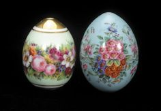 Property from the Royal House of Hanover: Two Russian Imperial Porcelain eggs, 19th century. Decorated with a continuous floral band of spring flowers set against a soft mint ground enclosed by a double gilt band, top and bottom gilt, the other decorated with floral bouquets loosely entwined with branches set on a turquoise ground.
