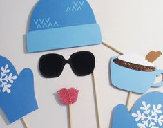 Winter Photo Booth Props - Adorable Ski Hat and Gloves shown in Winter Wonderland Blue. $20.00, via Etsy.