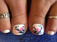 Pretty pedicure design, but I would want a different color, I don't really like white polish on my toes