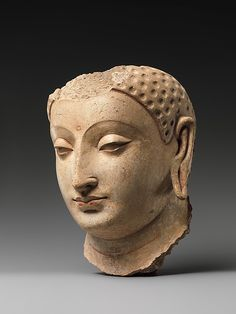 Head of Buddha  Date:     5th–6th century Culture:     Afghanistan (probably Hadda) Medium:     Stucco with traces of paint