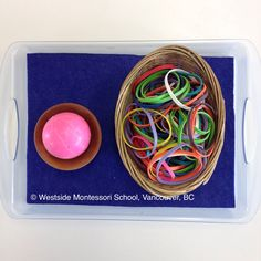 Montessori Practical Life Activity - putting rubber bands on a rubber ball. Great fine motor practice. It's also great to familiarize children with using rubber bands. Such a unique texture. @wmswms (Westside Montessori School, Vancouver, BC)