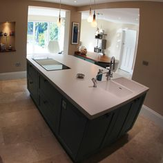 Large contemporary square kitchen island built to incorporate a structural pillar island design - Stylishly modern kitchen islands additional work surface ...